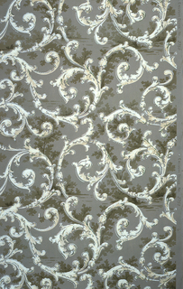 On dark gray ground, white scrollwork with some shaded branches.