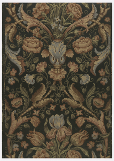 Imitation tapestry weave, with multi-colored floral and foliate motifs, on dark green glossy ground.