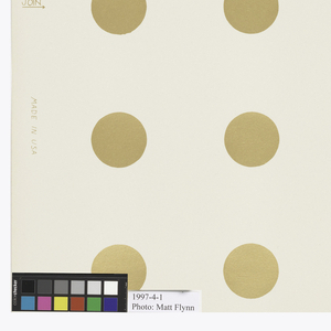 Rows of gold dots, evenly spaced and printed four across.  Printed in metallic gold on off-white ground.