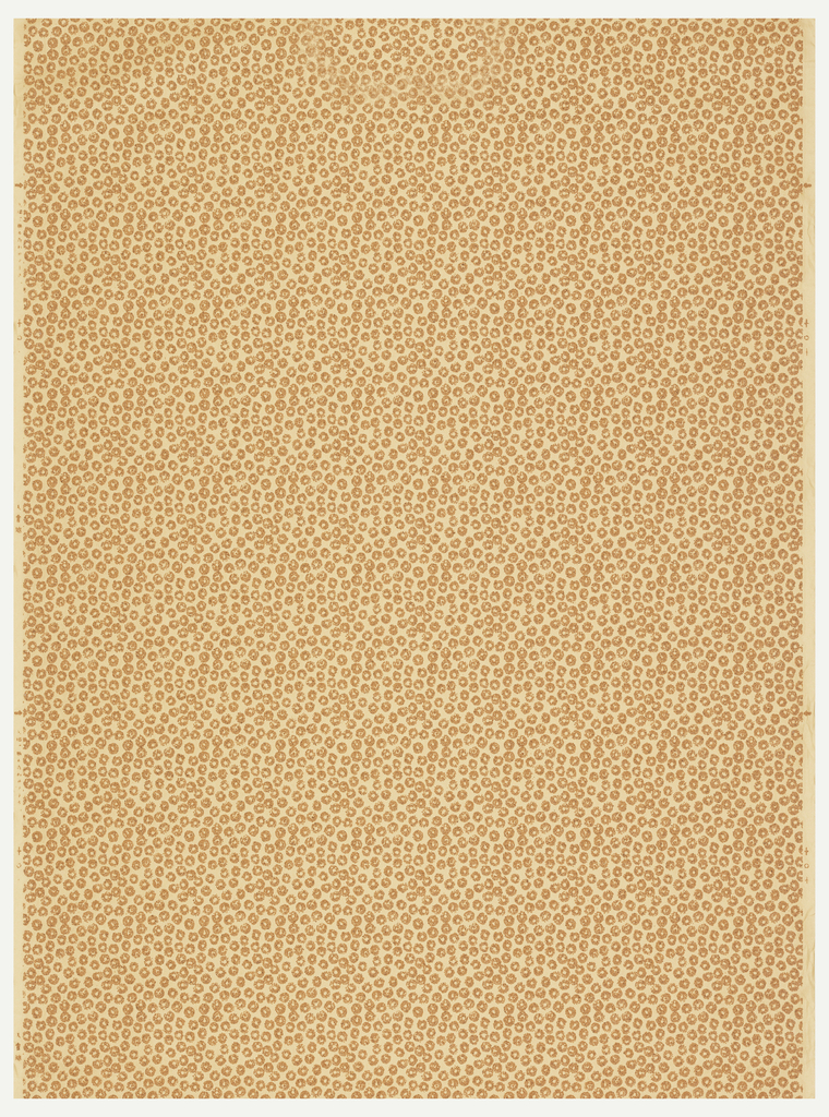 Small-scale pattern of irregular circle motifs on a luster ground. The design is composed of applied ground walnut shells in a tan color on a slightly irridescent lighter tan background.