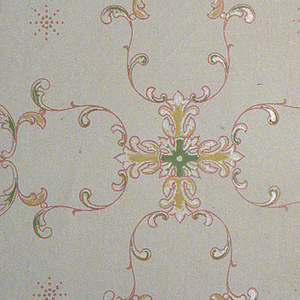 On gray ground, treillage of green, red and yellow scrolls with cross-shaped floral motifs in green, yellow, and white framed with red.