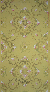 On tan ground, treillage in scrolls with large floral and scroll motifs at interstices composed of pink and white flowers.