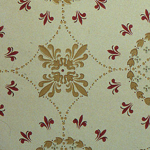 On light gray ground, treillage of wreaths in tan with burgundy fleurs de lis and floral motifs.