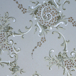 """Large waving scrolls with foliate scroll tendrils that alternate with other foliate scroll motifs. Each motif is filled with a simplified petal design, and the large waving scrolls have tendrils of the simplified petal design. Ground is light green. Printed in greens, yellow, white mica and gold mica.  Printed in selvedge: """"Janeway & Co."""""""