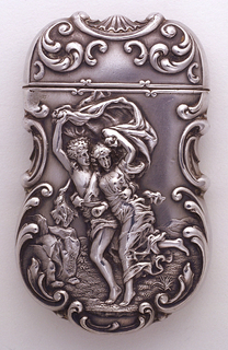 Oblong, curved top, bottom and corners, sides slightly indented just above center, featuring raised decoration of running couple in loose, flowing garments, each holding end of billowing cloth above their heads, he has arm clasped around her waist, all framed by scroll work. Reverse features inscribed monogram and scroll work near edges. Lid hinged on side. Striker on bottom.