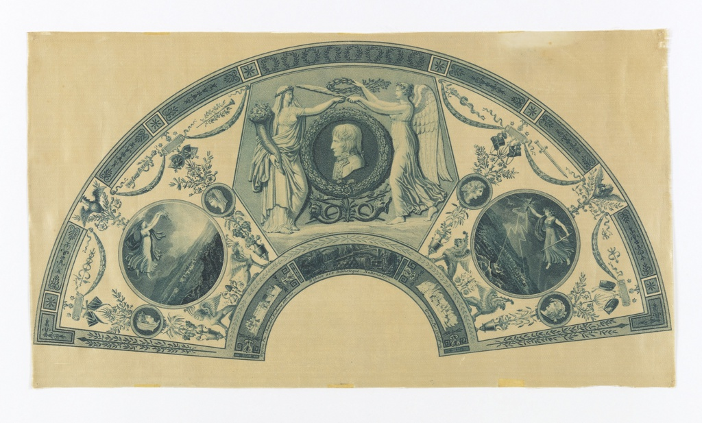 Unmounted fan leaf.  Cream satin printed by engraved plate in blue. At center, a profile bust of Napoleon being crowned with laurel by Abundance and Victory. The medallion on the left contains Peace scattering flowers, and on the right, War hurling lightning. Surrounded by ornaments, garlands, and architectural details in the neoclassical style.