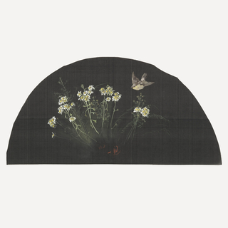 Black fan leaf painted with gouache showing bird in flight with daisies.