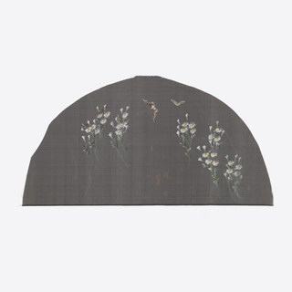 Black fan leaf painted with gouache showing daisies and butterflies.