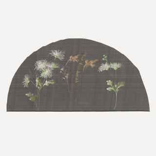 Black fan leaf painted with gouache showing white flowers with two brown birds in flight.