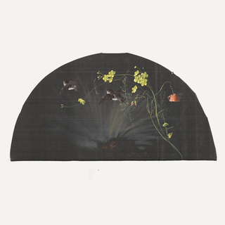 Black fan leaf painted with gouache showing yellow flowers with two brown birds in flight.