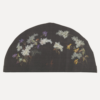 Black fan leaf painted with gouache showing white, purple and yellow flowers arranged in an arc.