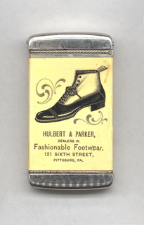 """Rectangular, curved top and bottom, featuring printed decoration of man's two-tone ankle boot, with lace and hook closures, inscribed on inside of boot """"Stacy Adams & Co."""", inscribed on boot loop at top of back """"Stacy Adams & Co."""", c-scroll motifs to upper left and lower right of boot, inscribed below """"Hulbert & Parker, Dealers in Fashionable Footwear, 121 Sixth Street, Pittsburg, PA."""" Reverse features small red griffon holding banner inscribed """"None But The Best"""" on upper left corner, below inscription reads in various typefaces """"Stacy Adams & Co., Makers of Fine Shoes, $5.00 & $6.00,"""" in fine print below inscribed """"The Whitehead & Hoag Co., Newark, N.J."""" Both side panels inscribed """"None But The Best."""" Lid hinged on side. Striker on bottom."""