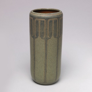 Vase with carved geometric decoration.