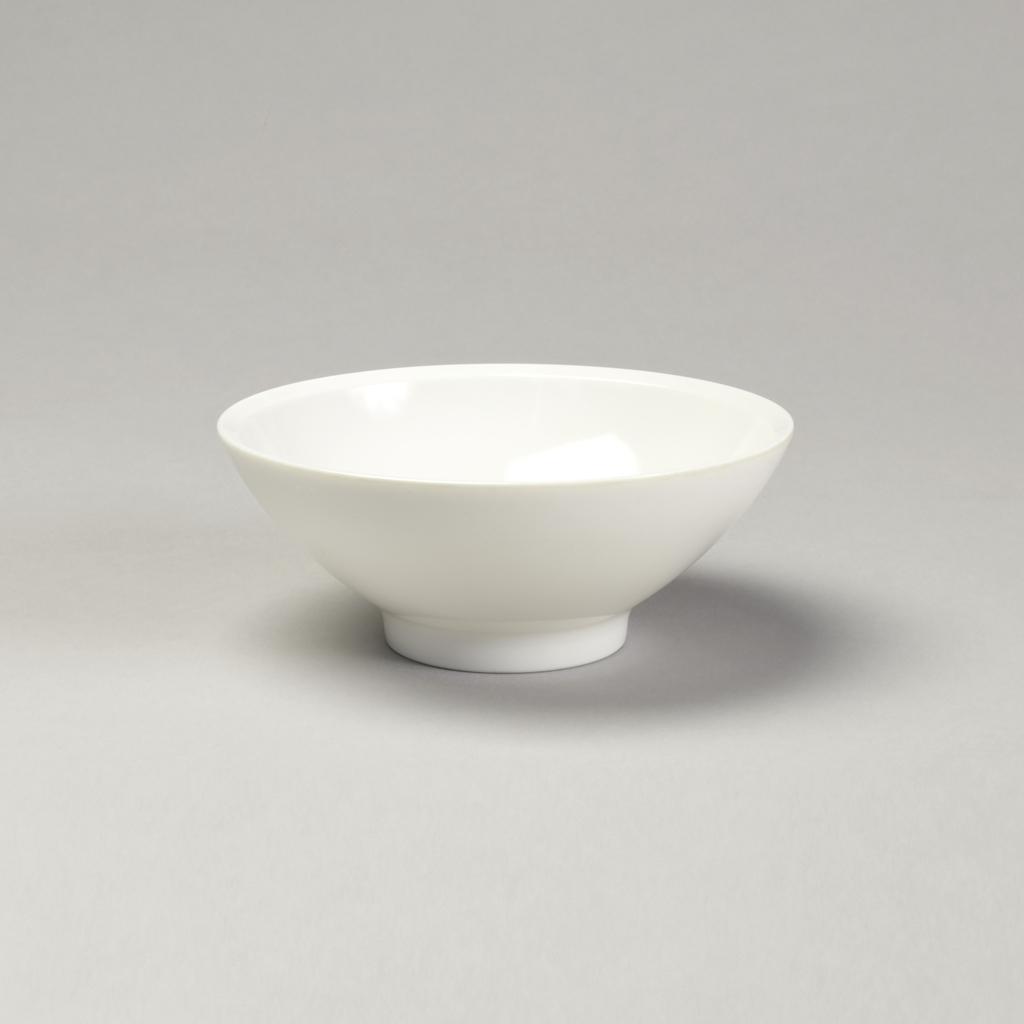 Eggshell-colored softly rounded flaring bowl with beveled edge.