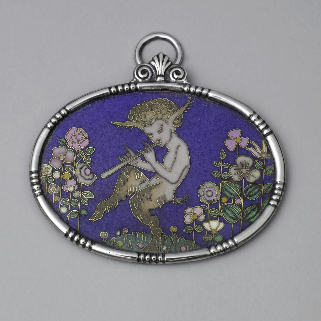 Oval plaque, with depiction in cloisonne enamel of Faun playing pipe amidst flowers.  Blue background, multicolored figures.  Mounted in silver frame with suspension ring.