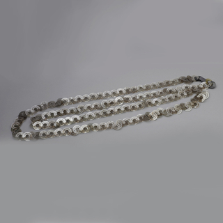 Rings linked together on a strand of silver.