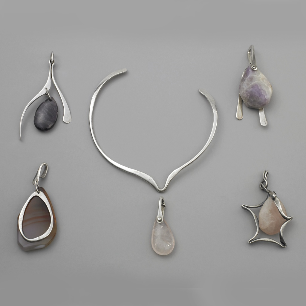 Pendant composed of purple-white ovoid stone depending from silver loop; inverted V-shaped flattended silver wire form attached to face.