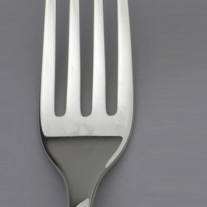 Sterling silver fork with closed loop at end of handle.
