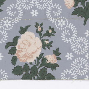 """The design is composed of diagonal rows of diamond-shaped medallions with floral borders simulating lace work. The centers of medallions contain alternating motifs of sprays of roses, arranged in two different designs. Printed on margin: """"Imperial Washable Wallpaper. Run 16, Union Made. Made in U.S.A. Color - Locked and Guaranteed. #2530. U.S. Patent No. 1950279."""" Printed in pink, green and white on gray field."""