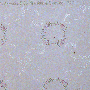 On gray ground, small wreaths in green and pink with lightly printed white C-scrolls. Printed on off-white ground.