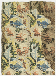 "Woven silk textile with ""bizarre"" pattern showing large flowers and leaves against a background of architectural motifs including a balustrade and paved path with planter."