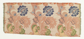 Fragments of a continuous pattern in the bizarre style showing three scrolling vines placed side by side, vertically. The main form of the scroll is ivory on top of which twists florals in blue, violet, green and yellow, on a rose ground. Both selvages present.
