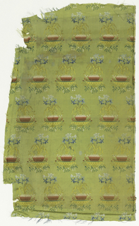 Fragment of woven fabric. Offset rows of a flowering plant or bulb on a dish [alternate rows counterfaced] in multi-colors on a green-yellow background.