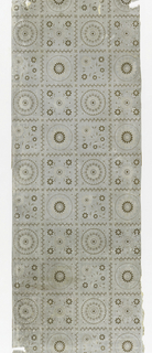 Tile pattern, with large stylized floral ornaments alternating with small floral arrangements, printed in tan on gray ground, on embossed paper simulating textile weave.
