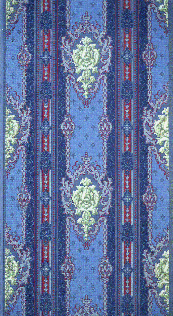 Bold multi-color stripe, alternating with foliate medallions. Printed in blue, red and green on blue ground.