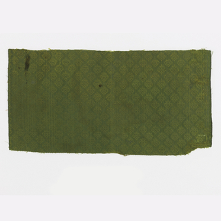 Small-scale designs in olive green. One selvage.