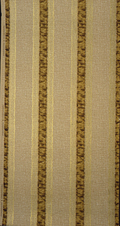Narrow mottled brown stripe, alternating with a wide tan stripe. There is a gold lace-like stripe on either side of the dark stripe.