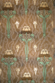 Large-scale stylized floral motif, possibly tulip, alternating with a very small gold motif. Printed in tan, brown and metallic green on a brown moire-like ground.