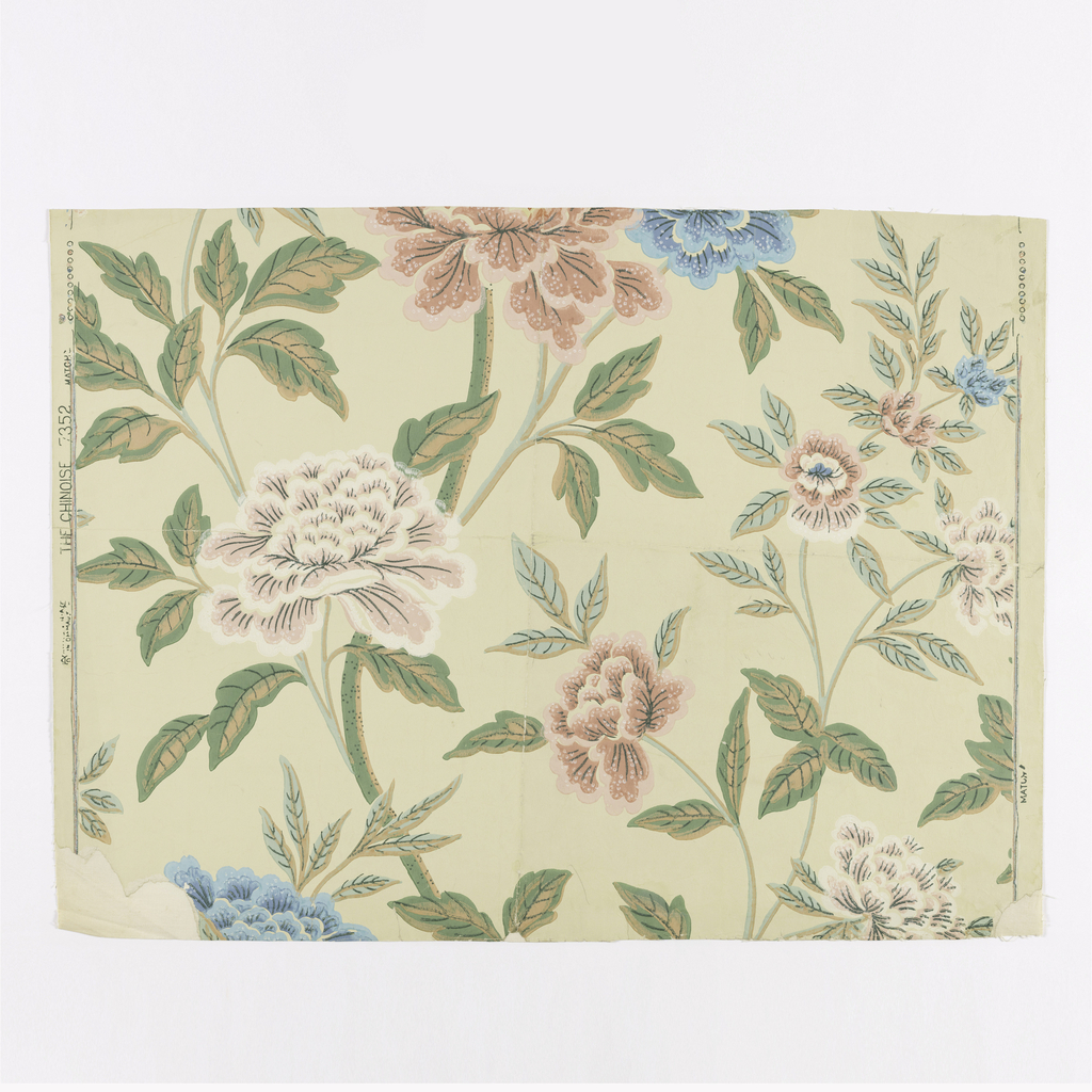 Design of branching stems and large open flowers (peonies) and leaves. Printed in blue, pink, green, brown and white on a pale yellow ground.