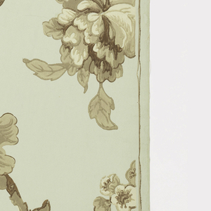 Design of branching stems with large and small flowers and leaves printed in three shades of brown on pale green ground.