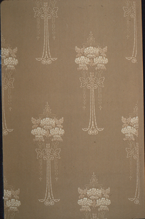 On light brown textured ground, tall vase-like motifs in white with clusters of flowers.