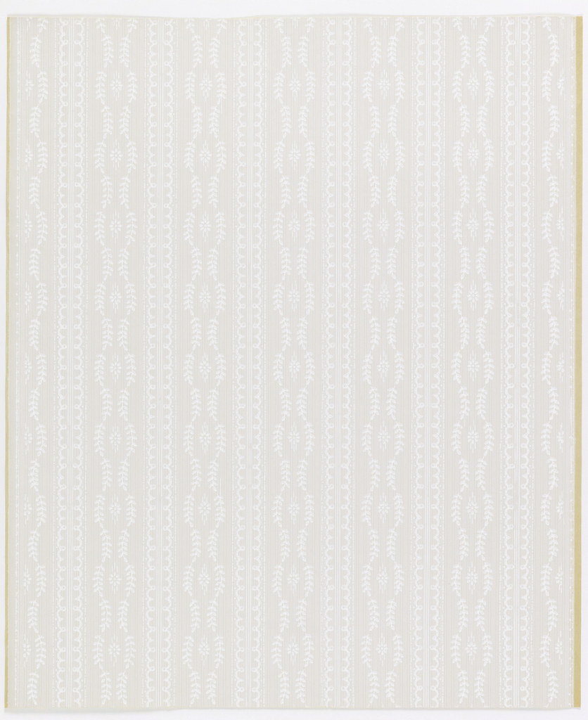 Vertical bands of leafy twigs enclosing small flower, alternating with double band of eyelets; white on gray ground. Adaptation of Louis XVI textile pattern.