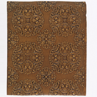 Motifs of rosette, 'C'-scroll and starburst. Printed in umber.