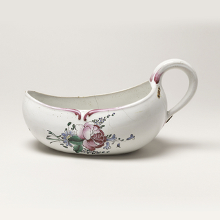 Oval boat-shaped vessel with handle at high back end. White ground with red tulip on once side of body, red rose on other. Small floral spray at front.