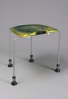 D-shaped, contoured yellow-green epoxy seat mounted on four bent tubular steel legs with conical black rubber feet; tops of feet wrapped in coiled steel wire.