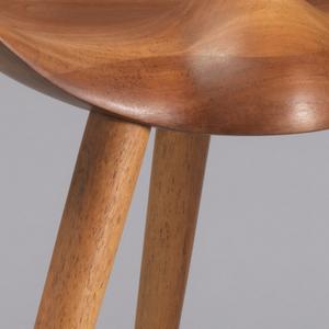 Semi-circular contoured, concave seat on three splayed, tapering legs.