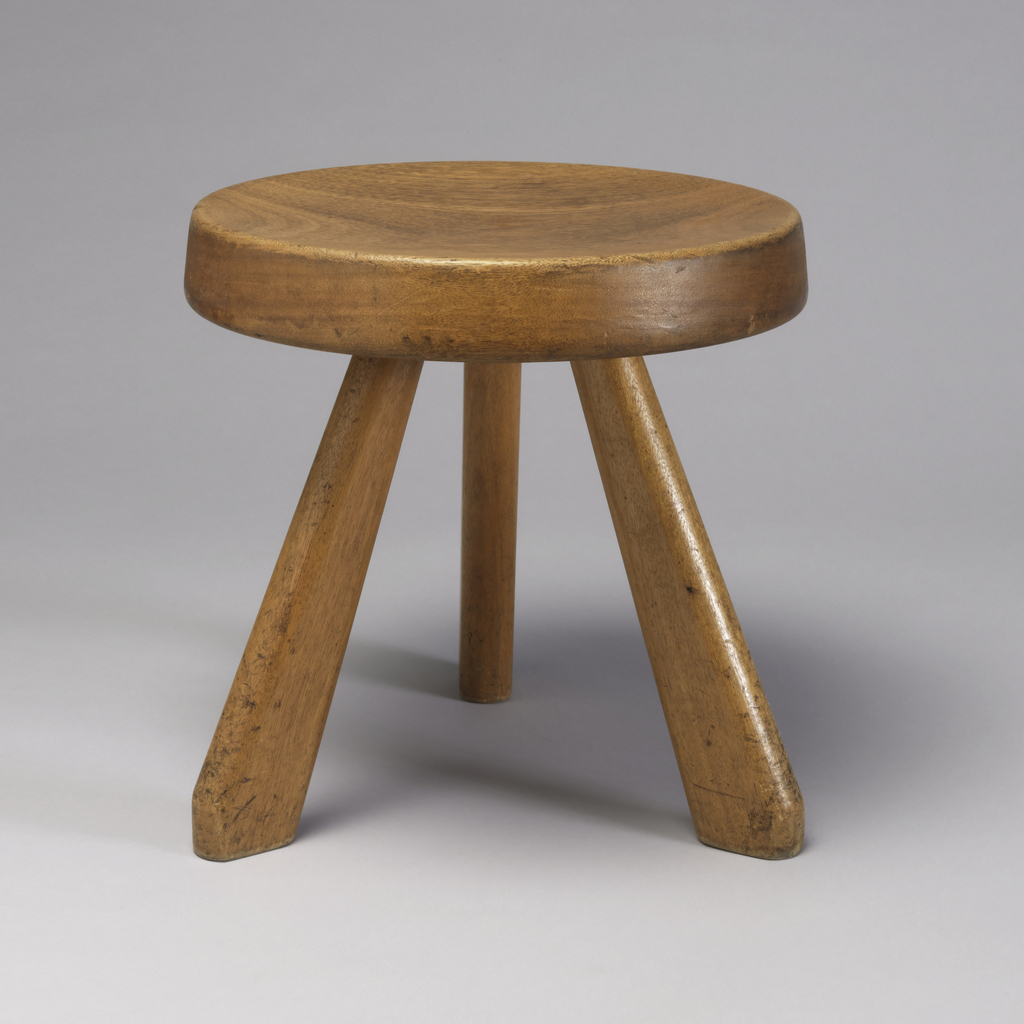 Form composed of thick, slightly concave circular pine seat on three splayed pine legs.