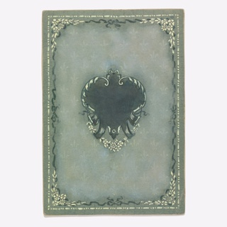 On gray ground, light pattern of fleurs-de-lys, upon which is a black cartouche composed of somewhat heart shape with bright yellow rinceaux and flowers below. Page is framed with border of black ribbon and yellow dots.