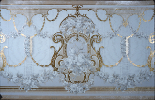 On light blue ground, medallion at center with scalloped gold edges with clusters of gray and white flowers; gold and floral gray rinceaux.