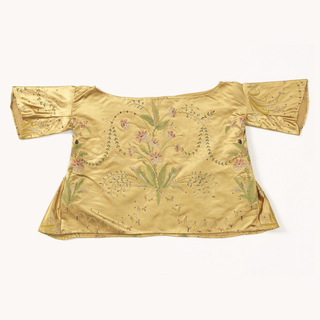 Yellow silk satin blouse embroidered in point de chainette stich with flowers in green, pink and white silk.