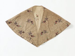 Cape for a young girl of printed calico with pink, green, and purple flowers sprinkled over a small ground pattern of dark brown curling lines.