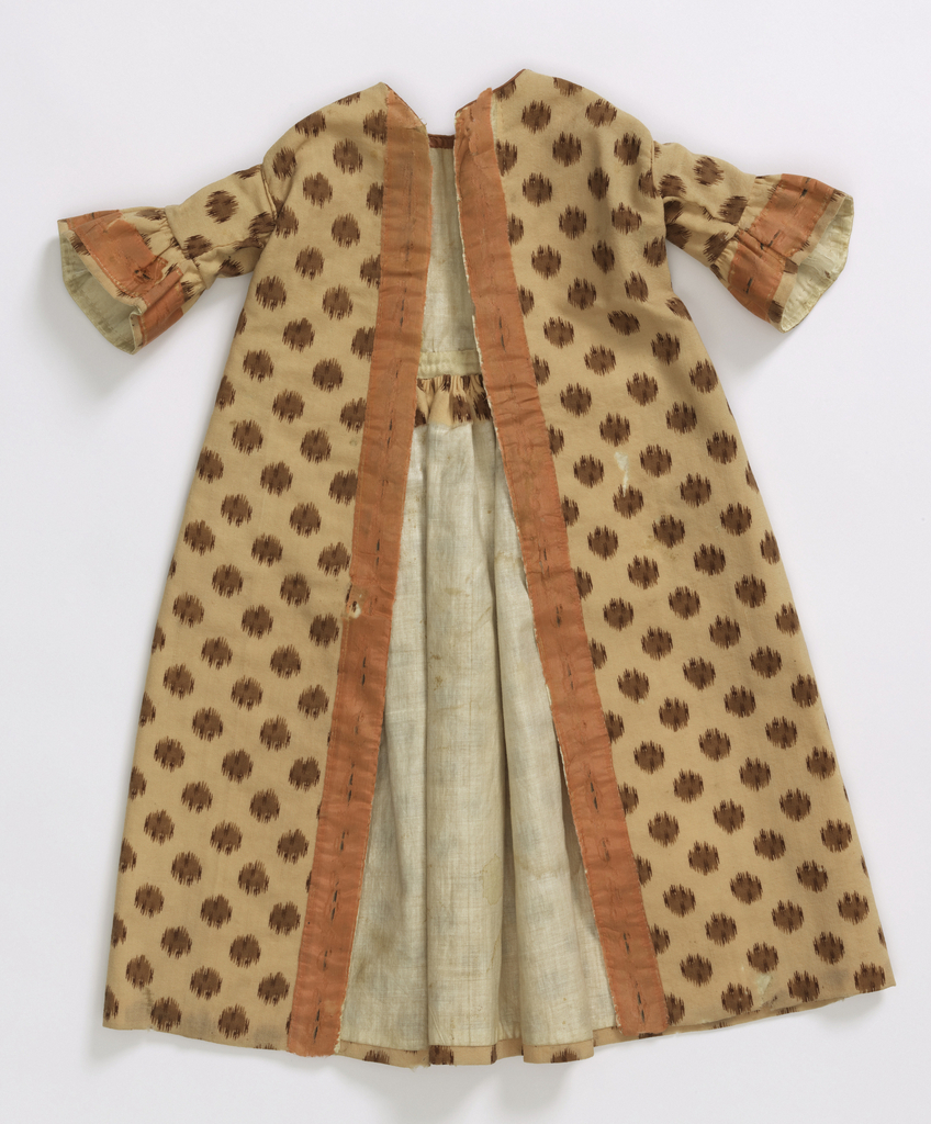 Long wrapper with front opening, dropped shoulder adn elbow-length sleeves with deep ruffles. Fine tan wool printed with small blazes in deeper browns. Broad salmon pink silk ribbon applied as border on sleeve ruffles and down fronts. Broad white silk ribbon applied as lining to fronts; remainder lined with white glazed cotton.
