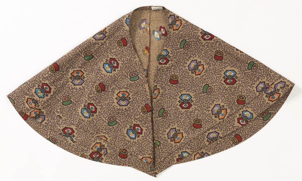 Caplet of plain weave cotton printed with allover pattern of purple scrolling leaves with larger scattered polychrome shapes.