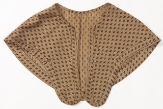Caplet of plain weave cotton printed with allover pattern in shades of brown showing stylized flowers within dashed hexagons.