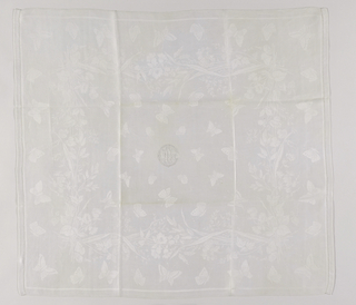 Damask napkins to match tablecloth with monogram of Louise Carnegie in the center.