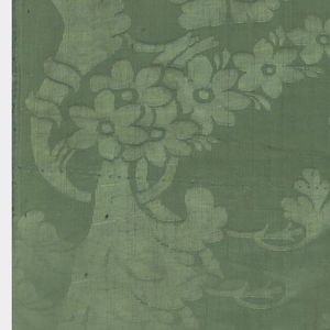 Dark green silk with two curving floral sprays vertically offset.